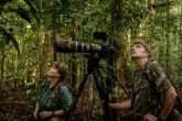 Tim Laman and and Cheryl Knott following an orangutan in Gunung Palung, Borneo. Photo by Robert Suro.